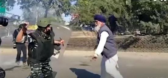 Police beat farmer